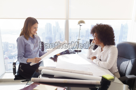 multiethnic team architect women with plans