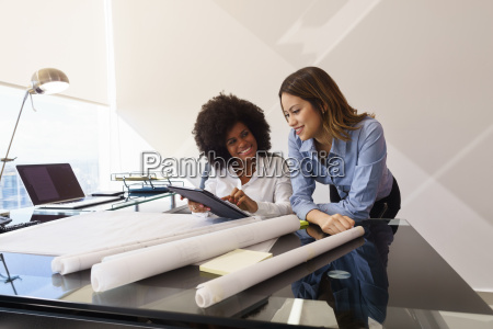 women colleagues architect with tablet pc