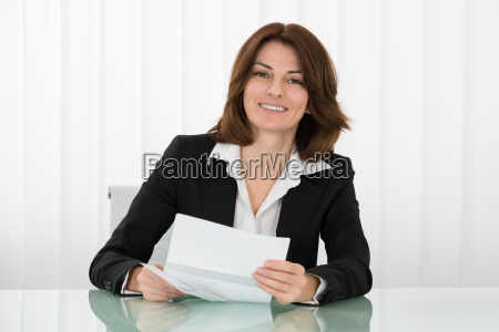 happy businesswoman holding envelope with letter