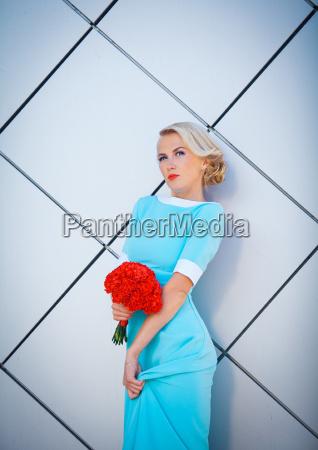 daring blonde rebel with brightly painted