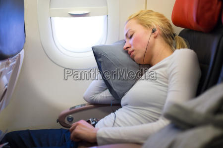 lady traveling napping on a plain