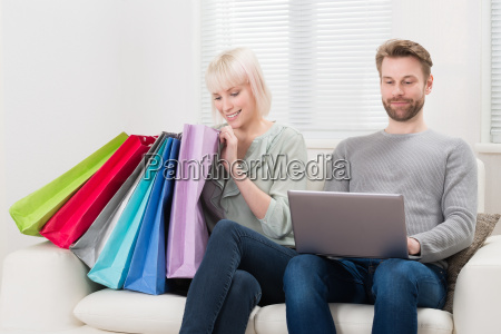 young couple with shopping bags and