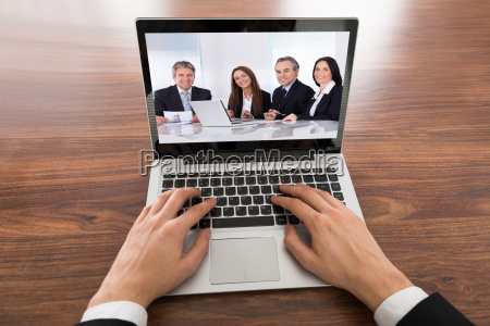 close up of businessman video conferencing