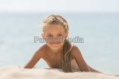 six year tanned girl lying on