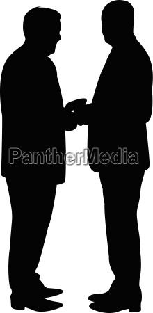schwarze silhouetten von zwei maennern stehen