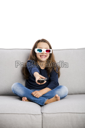 girl holding a tv remote