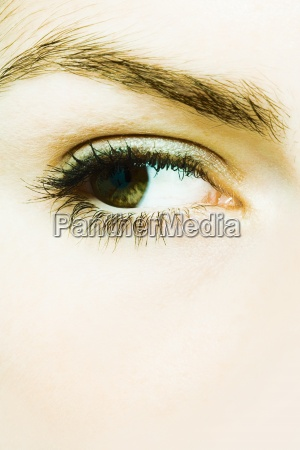young womans eye extreme close up