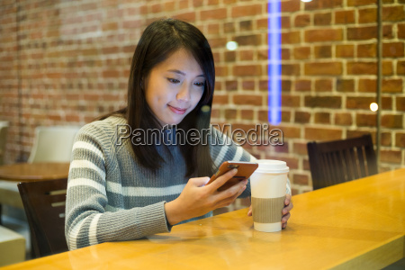 asian young woman use of cellphone