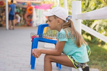girl six years sitting in the