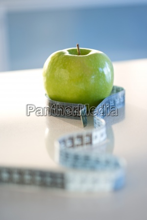 green apple with tape measure around