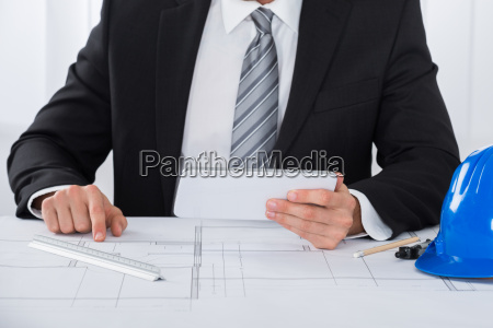 male architecture using digital tablet