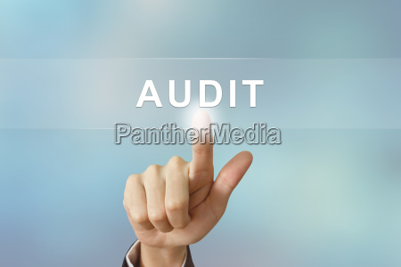 business hand clicking audit button on