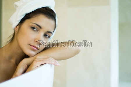woman resting head against side of