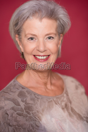 studio portrait against red background