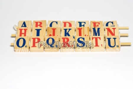 wooden alphabet blocks lined up close