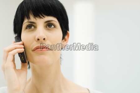 woman using cell phone looking up