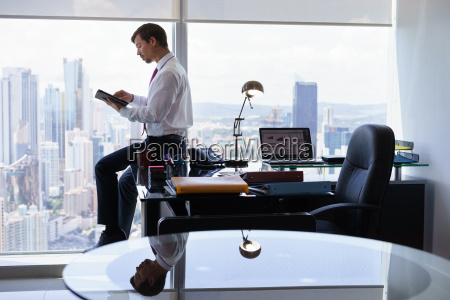 business person reads news on tablet