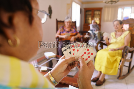 old women have fun playing card