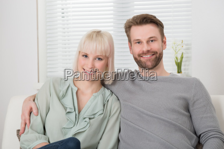 couple sitting close together on sofa