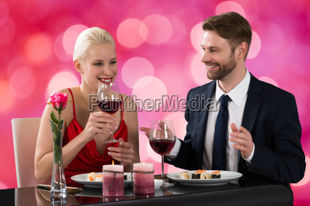 young couple having dinner in a