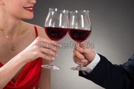 young couple toasting wine in a