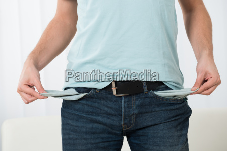 young man showing empty pockets
