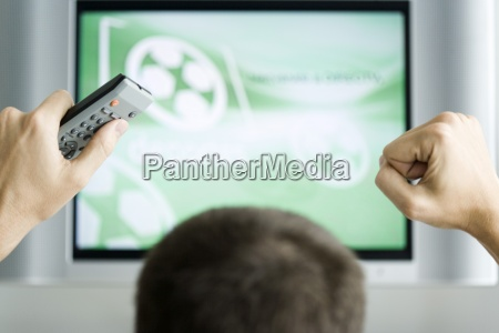person watching flat screen television hands