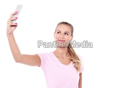 casual pretty woman taking a selfie