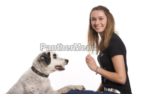 girl trains with her dog and