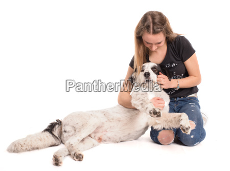 teen cuddles lovingly with her dog
