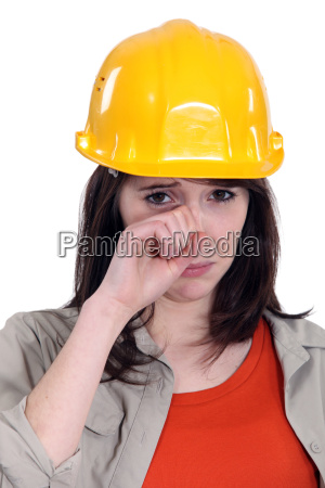 female laborer crying