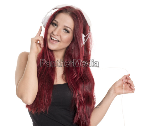 pretty redhead woman with headphone is