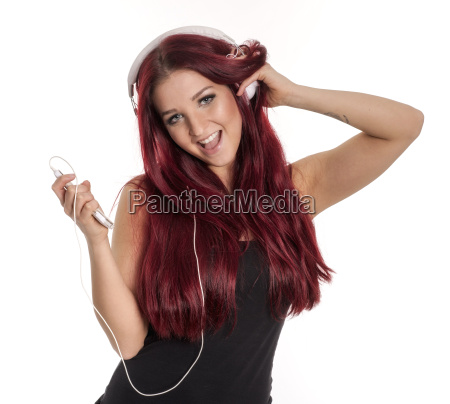redhead beautiful girl with headphone and