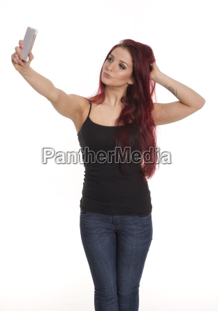 red haired pretty girl with mobile