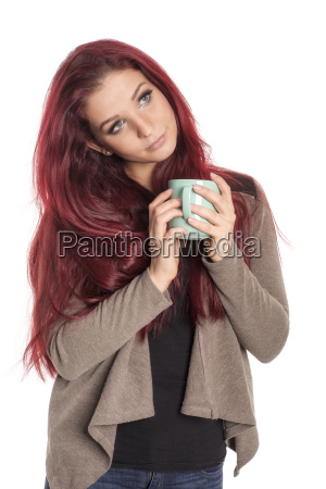 red haired beautiful woman is holding