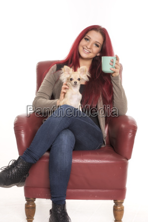 girl sits on a chair with