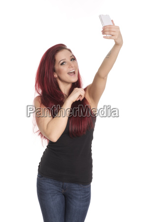 young woman with red hair makes