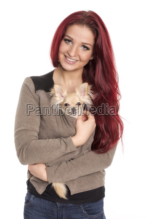 young woman warms a chihuahua in