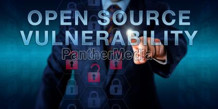 developer pressing open source vulnerability