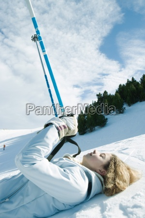young, female, skier, lying, on, ground, - 16690910