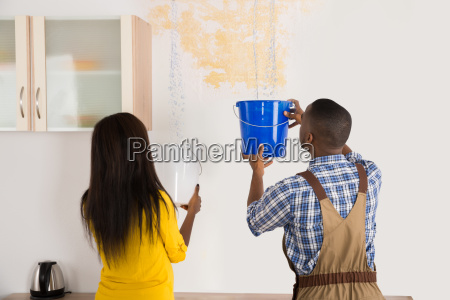 young woman and worker collecting water