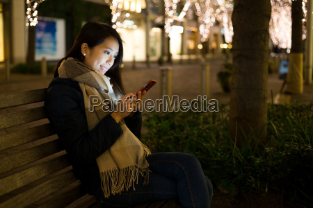 woman using smart phone in tokyo