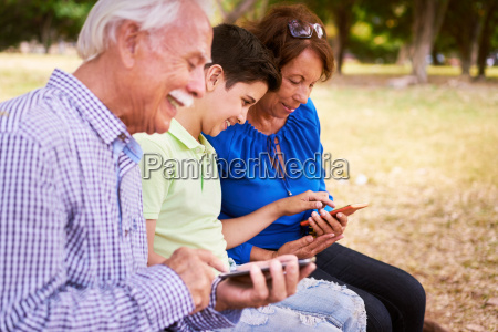 child helping grandma text messaging on