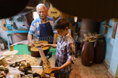 lute maker grandpa teaching boy grandson