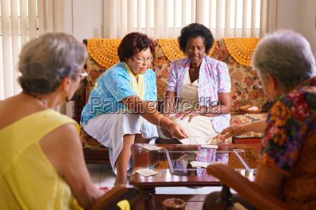 senior women playing card game in