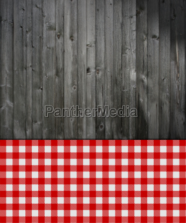 gray wood background with red tablecloth