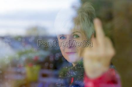 senior woman giving the finger
