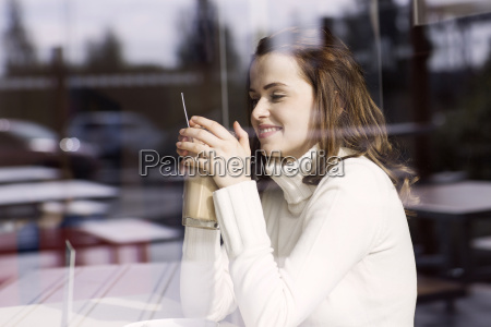 smiling young woman with latte macchiato
