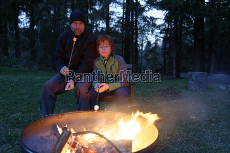 father and son at the campfire