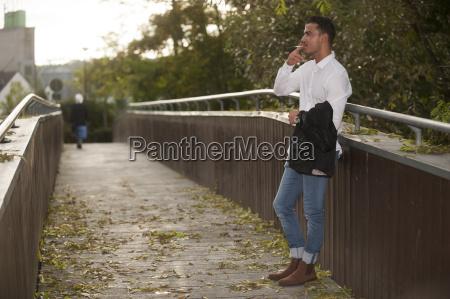 stylish young man smoking a cigarette